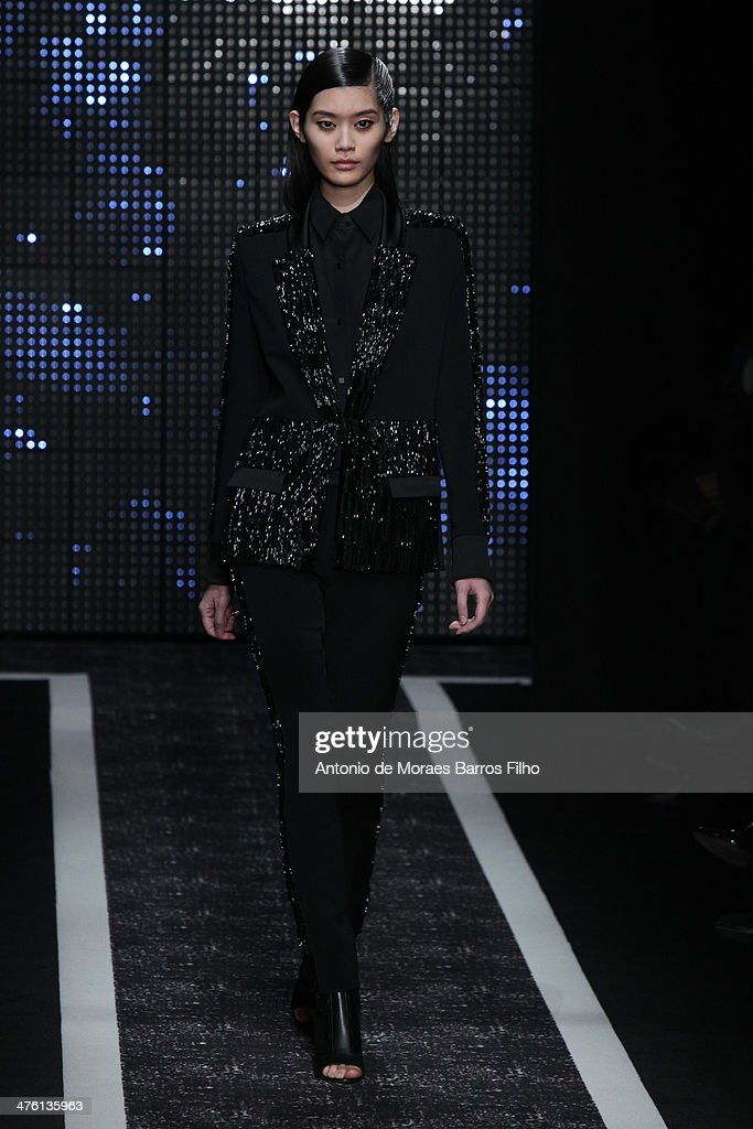 A model walks the runway during the Maxime Simoens show as part of the Paris Fashion Week Womenswear Fall/Winter 2014-2015 on March 2, 2014 in Paris, France.