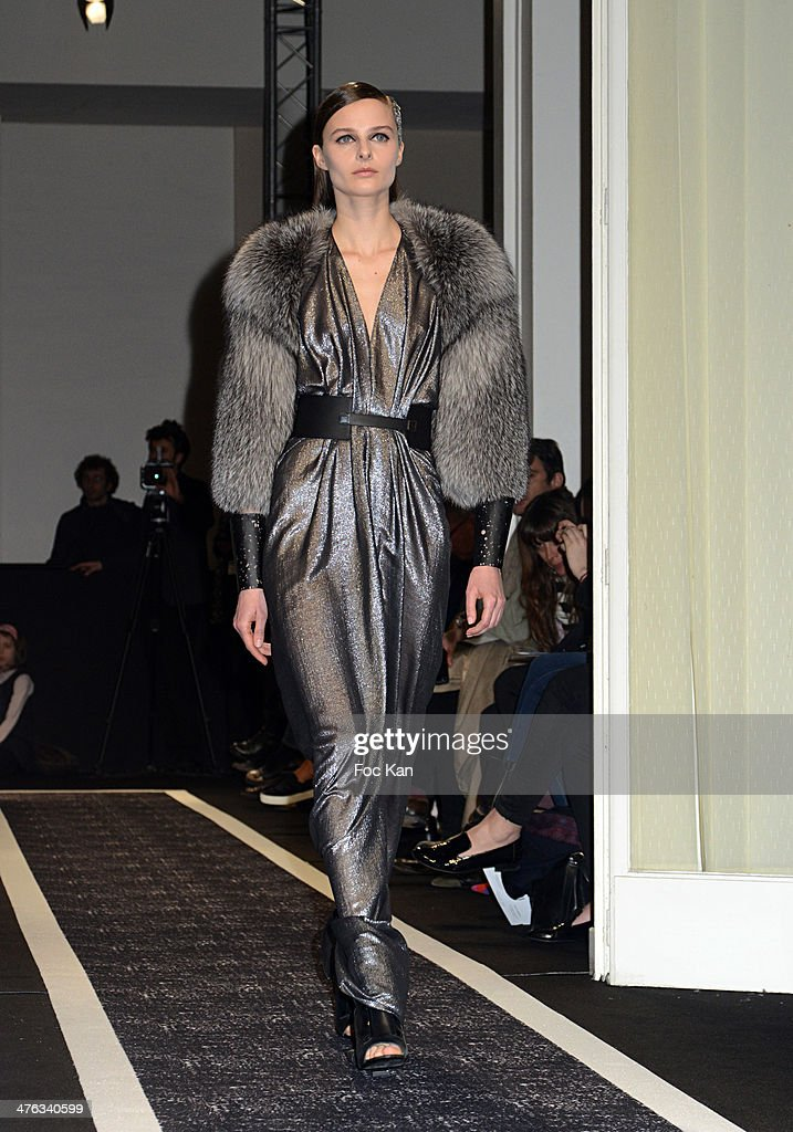 A model walks the runway during the Maxime Simoens show as part of the Paris Fashion Week Womenswear Fall/Winter 2014-2015 at Lycee Jean Zay on March 02, 2014 in Paris, France.