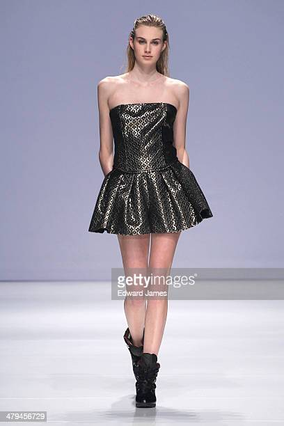A model walks the runway during the Melissa Nepton fashion show during World Mastercard fashion week on March 18 2014 in Toronto Canada