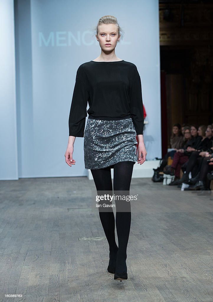 A model walks the runway during the Menckel show at Mercedes-Benz Stockholm Fashion Week Autumn/Winter 2013 at Berns on January 30, 2013 in Stockholm, Sweden.