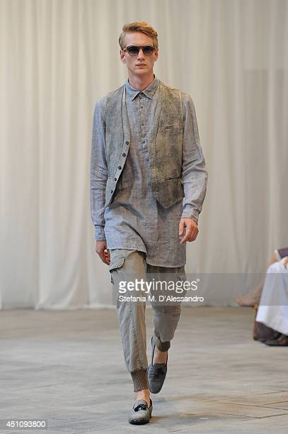 A model walks the runway during the Messagerie show as part of Milan Fashion Week Menswear Spring/Summer 2015 on June 23 2014 in Milan Italy