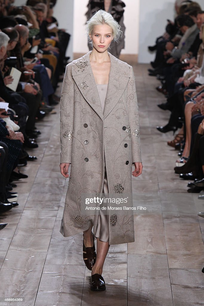 A model walks the runway during the Michael Kors fall 2014 fashion show on February 12, 2014 in New York City.