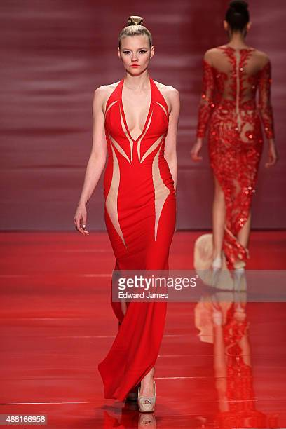 A model walks the runway during the Mikael D fashion show at David Pecaut Square on March 27 2015 in Toronto Canada