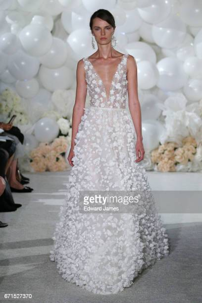 A model walks the runway during the Mira Zwillinger Spring/Summer 2018 bridal fashion show on April 20 2017 in New York City