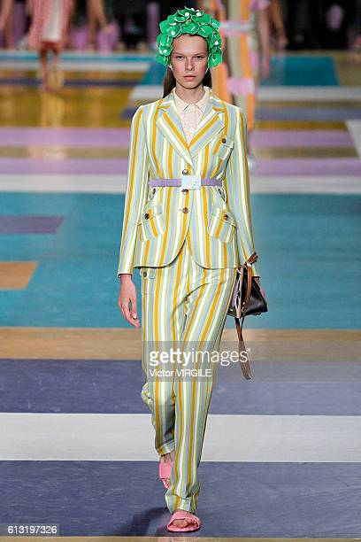 A model walks the runway during the Miu Miu Ready to Wear fashion show as part of the Paris Fashion Week Womenswear Spring/Summer 2017 on October 5...