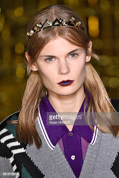 A model walks the runway during the Miu Miu Ready to Wear show as part of the Paris Fashion Week Womenswear Spring/Summer 2016 on October 7 2015 in...
