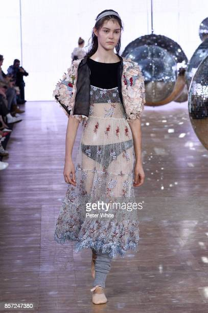 A model walks the runway during the Moncler Gamme Rouge Paris show as part of the Paris Fashion Week Womenswear Spring/Summer 2018 on October 3 2017...