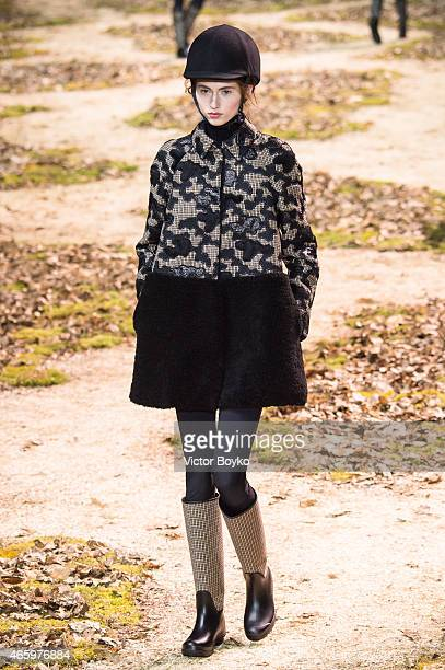 A model walks the runway during the Moncler Gamme Rouge show as part of the Paris Fashion Week Womenswear Fall/Winter 2015/2016 on March 11 2015 in...
