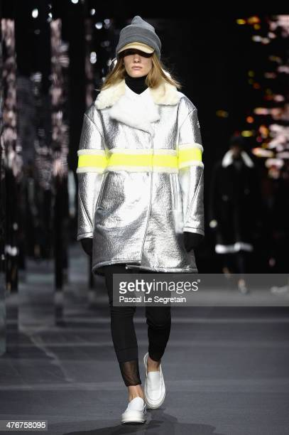 A model walks the runway during the Moncler Gamme Rouge show as part of the Paris Fashion Week Womenswear Fall/Winter 20142015 on March 5 2014 in...