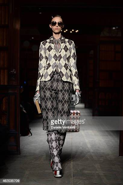 A model walks the runway during the Moncler show as a part of Milan Fashion Week Menswear Autumn/Winter 2014 on January 12 2014 in Milan Italy