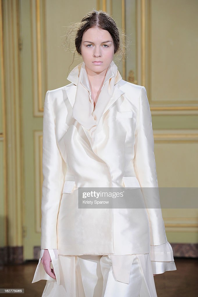 A model walks the runway during the Moon Young Hee Fall/Winter 2013/14 Ready-to-Wear show as part of Paris Fashion Week at Hotel de Varengeville on February 26, 2013 in Paris, France.