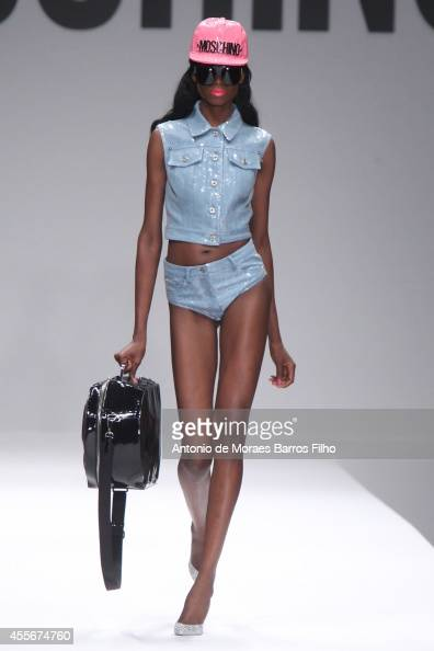 A model walks the runway during the Moschino show as a part of Milan Fashion Week Womenswear Spring/Summer 2015 on September 18 2014 in Milan Italy