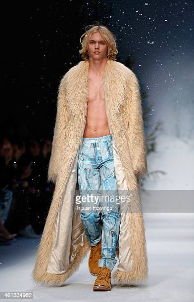 A model walks the runway during the Moschino show at the London Collections Men AW15 at on January 11 2015 in London England