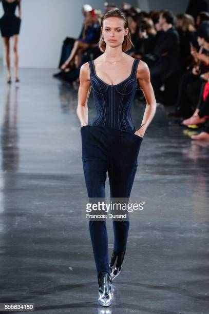 A model walks the runway during the Mugler show as part of the Paris Fashion Week Womenswear Spring/Summer 2018 on September 30 2017 in Paris France