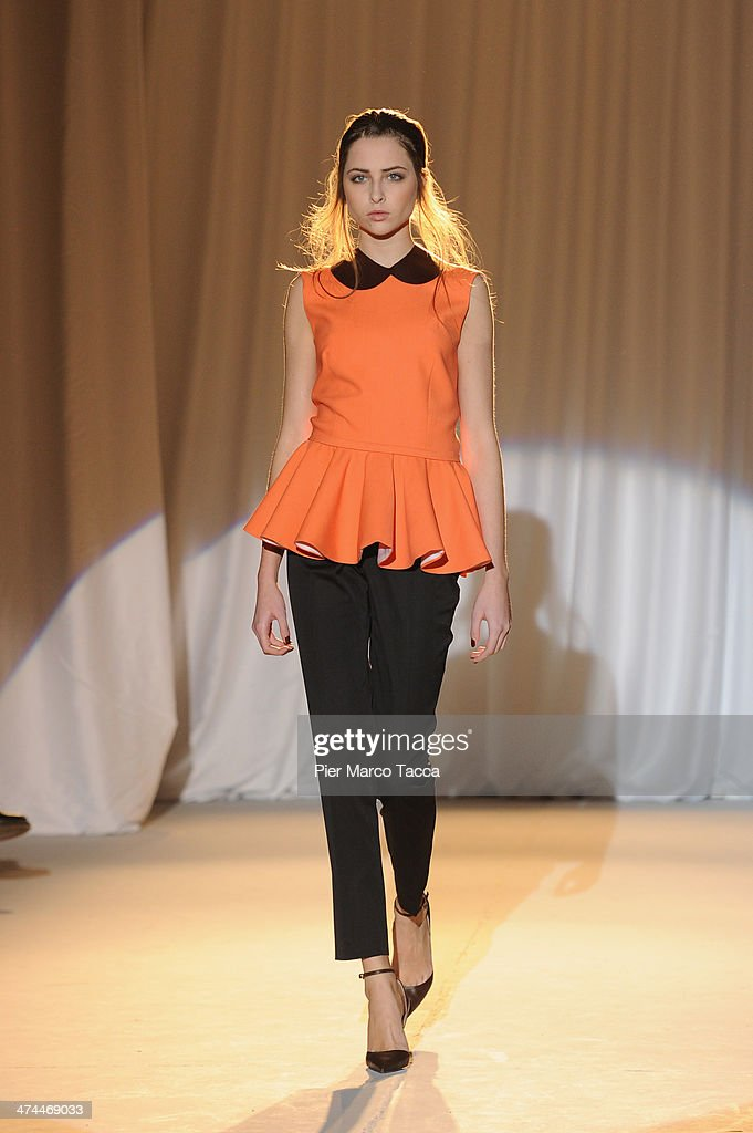 A model walks the runway during the Musso show as part of Milan Fashion Week Womenswear Autumn/Winter 2014 on February 23 2014 in Milan Italy