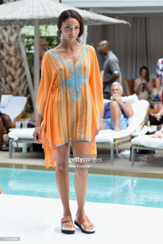 A model walks the runway during the Nanette Lepore Swim Press Preview during Mercedes-Benz Fashion Week Swim 2014 at the SLS Hotel on July 21, 2013 in Miami, Florida.