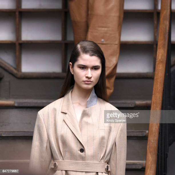 A model walks the runway during the Nehera show as part of Paris Fashion Week Womenswear Fall/Winter 2017/2018 on March 1 2017 in Paris France
