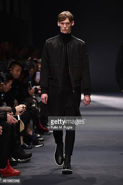 A model walks the runway during the Neil Barret Show as a part of Milan Menswear Fashion Week Fall Winter 2015/2016 on January 17 2015 in Milan Italy