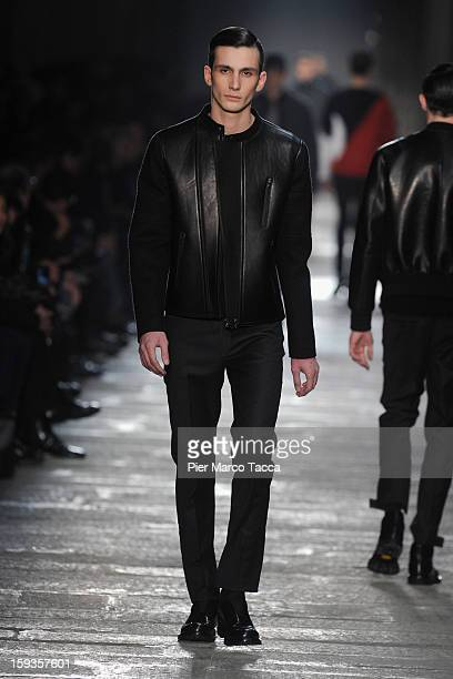 A model walks the runway during the Neil Barrett show as a part of Milan Fashion Week Menswear Autumn/Winter 2013 on January 12 2013 in Milan Italy