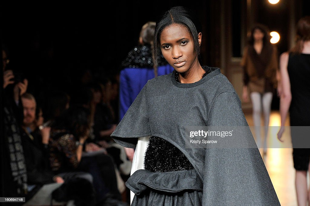A model walks the runway during the 'New Stylists Podium, 4th Edition' Fashion Show at the Hotel Westin on February 4, 2013 in Paris, France.