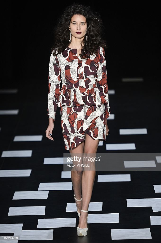 A model walks the runway during the Nica Kessler Fall/Winter 2013 fashion show at Fashion Rio on November 09, 2012 in Rio de Janeiro, Brazil.