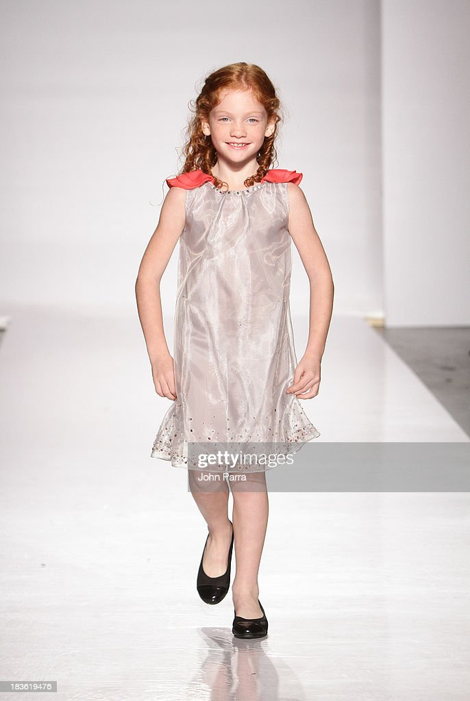 A model walks the runway during the Nicole Sandra Monfils preview at the Parsons The School For Design at petiteParade NY Kids Fashion Week in Collaboration with VOGUEbambini at Industria Superstudio on October 5, 2013 in New York City.