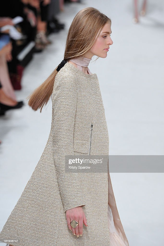 A model walks the runway during the Nina Ricci show as part of Paris Fashion Week Womenswear Spring/Summer 2014 on September 26, 2013 in Paris, France.