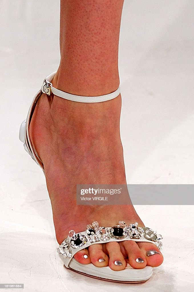 A model (shoe detail) walks the runway during the Nina Ricci show as part of Paris Fashion Week Womenswear Spring/Summer 2014 on September 26, 2013 in Paris, France.