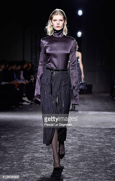 A model walks the runway during the Nina Ricci show as part of the Paris Fashion Week Womenswear Fall/Winter 2016/2017 on March 5 2016 in Paris France