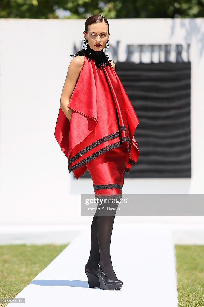 A model walks the runway during the Nino Lettieri Couture fashion show as part of AltaRoma AltaModa Fashion Week Autumn/Winter 2013 on July 6, 2013 in Rome, Italy.