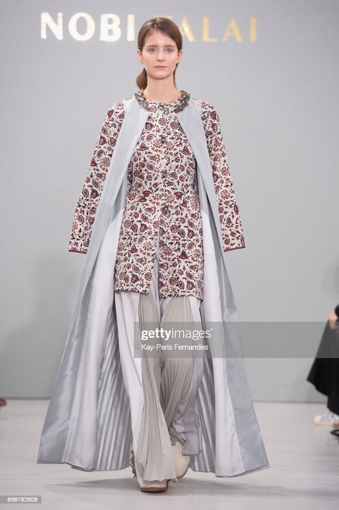 model-walks-the-runway-during-the-nobi-talai-paris-show-as-part-of-picture-id856782608