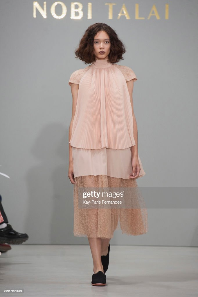 model-walks-the-runway-during-the-nobi-talai-paris-show-as-part-of-picture-id856782908
