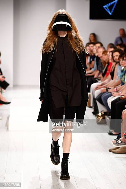 A model walks the runway during the Odeur show during the MercedesBenz Fashion Week Spring/Summer 2015 at Erika Hess Eisstadion on July 11 2014 in...