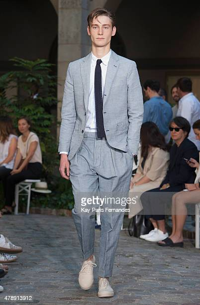 A model walks the runway during the Officine Generale Menswear Spring/Summer 2016 show as part of Paris Fashion Week on June 28 2015 in Paris France