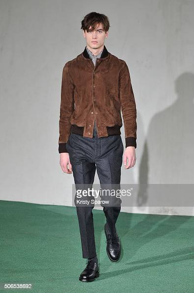 A model walks the runway during the Officine Generale Menswear Fall/Winter 20162017 show as part of Paris Fashion Week on January 24 2016 in Paris...