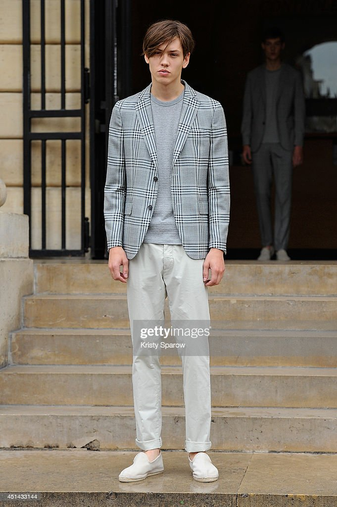 A model walks the runway during the Officine Generale show as part of Paris Fashion Week Menswear Spring/Summer 2015 on June 29, 2014 in Paris, France.