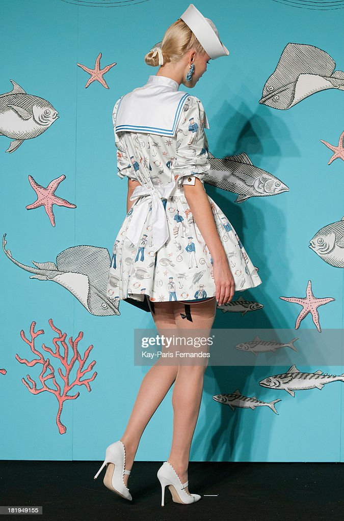 A model walks the runway during the Olympia Le Tan show as part of the Paris Fashion Week Womenswear Spring/Summer 2014 at the Paris Aquarium on September 26, 2013 in Paris, France.