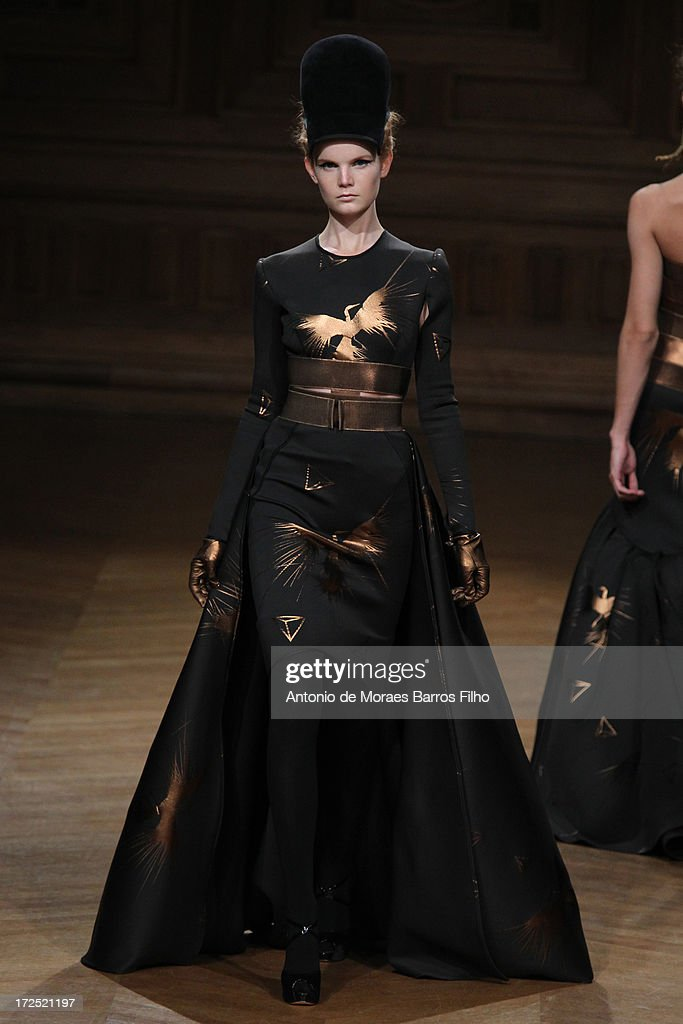 A model walks the runway during the Oscar Carvallo show as part of Paris Fashion Week HauteCouture Fall/Winter 20132014 at Musee Bourdelle on July 2...