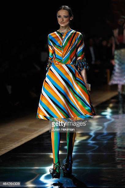 A model walks the runway during the Oscar Carvallo show as part of Paris Fashion Week Haute Couture Spring/Summer 2014 on January 21 2014 in Paris...
