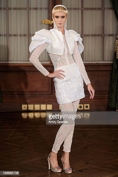 A model walks the runway during the Oscar Carvallo Spring/Summer 2013 HauteCouture show as part of Paris Fashion Week at ShangriLa Hotel Paris on...
