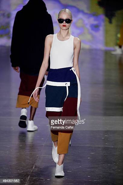 A model walks the runway during the Osklen fashion show at Sao Paulo Fashion Week Winter 2016 on October 21 2015 in Sao Paulo Brazil