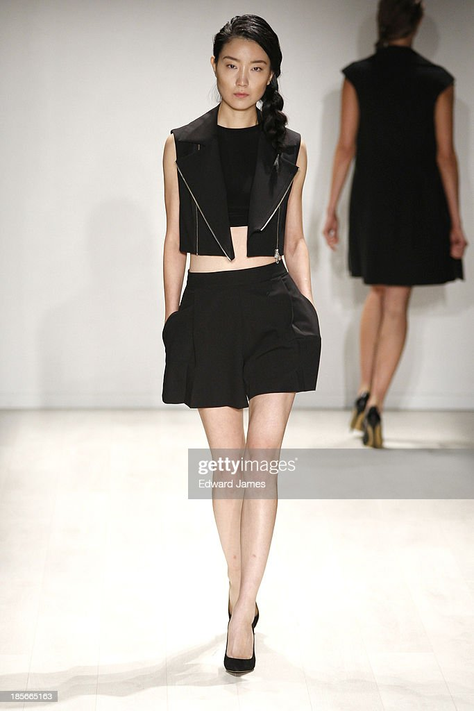 A model walks the runway during the Pariah Shirvani fashion show at David Pecaut Square on October 23, 2013 in Toronto, Canada.