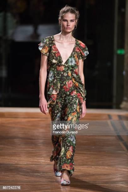 A model walks the runway during the Paul Joe Paris show as part of the Paris Fashion Week Womenswear Spring/Summer 2018 on October 3 2017 in Paris...