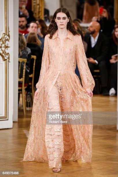 A model walks the runway during the Paul Joe Paris show during Paris Fashion Week Womenswear Fall/Winter 2017/2018 on March 7 2017 in Paris France