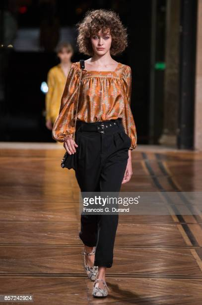 A model walks the runway during the Paul Joe show as part of the Paris Fashion Week Womenswear Spring/Summer 2018 on October 3 2017 in Paris France