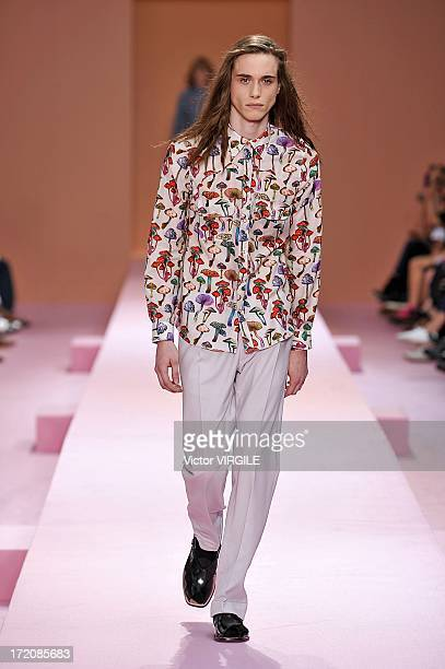A model walks the runway during the Paul Smith Ready to Wear Menswear Spring/Summer 2014 show as part of the Paris Fashion Week on June 30 2013 in...