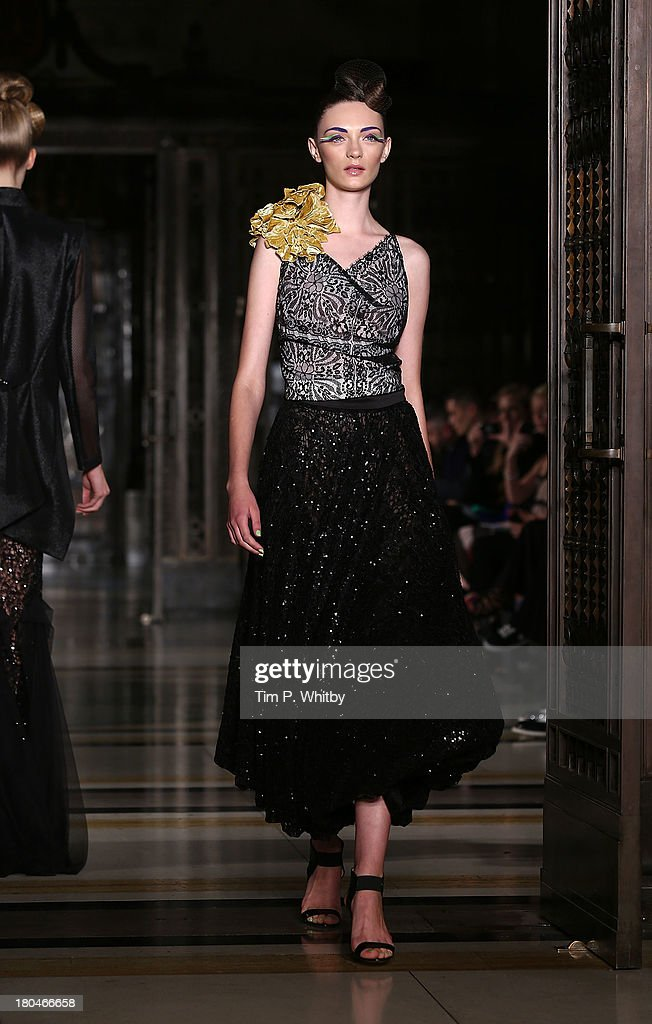 A model walks the runway during the Pearce Fionda show at London Fashion Week SS14 at Freemasons Hall on September 13, 2013 in London, England.