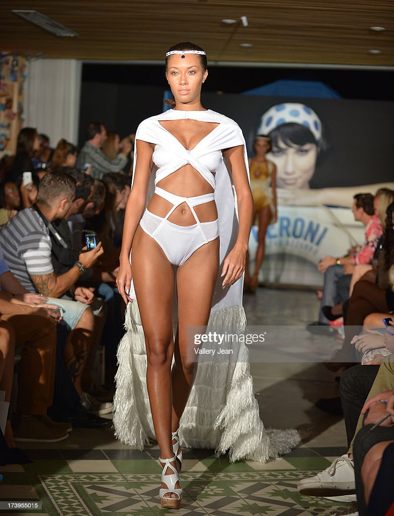 A model walks the runway during the Peroni Emerging Designer Series presented by Fashion Group on July 17, 2013 in Miami, Florida.