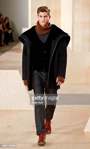 A model walks the runway during the Perry Ellis runway show during New York Fashion Week Men's Fall/Winter 2016 at Skylight at Clarkson Sq on...
