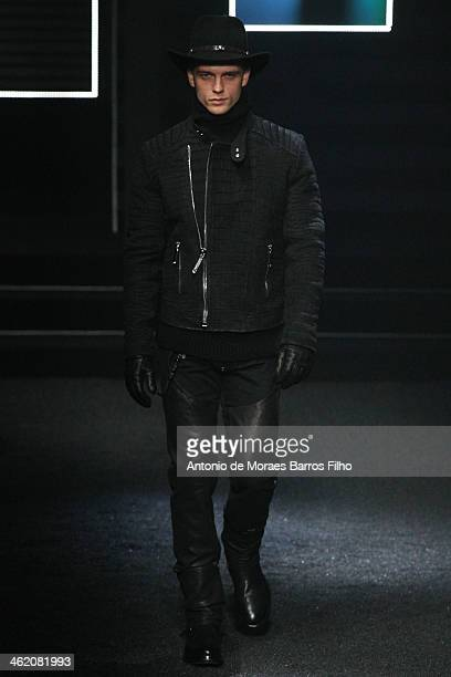 A model walks the runway during the Philipp Plein show as a part of Milan Fashion Week Menswear Autumn/Winter 2014 on January 12 2014 in Milan Italy